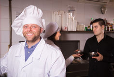 Chefs and waiter working Royalty Free Stock Images