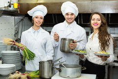 Chefs and waitress at kitchen royalty free stock photo