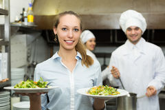 Chefs and waitress at kitchen Royalty Free Stock Image