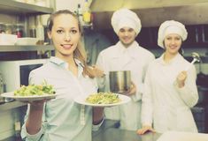 Chefs and waitress at kitchen Royalty Free Stock Images