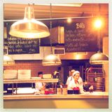 Chefs work in kitchen Stock Images
