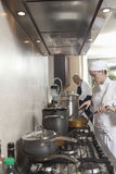 Chefs Working In Commercial Kitchen Royalty Free Stock Images