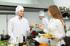Chefs and young waiter Royalty Free Stock Photo
