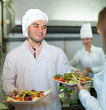 Chefs and young waiter Royalty Free Stock Photos