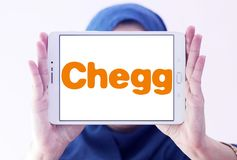 Chegg education technology company logo. Logo of Chegg company on samsung tablet holded by arab muslim woman. Chegg, Inc. is an American education technology royalty free stock photo