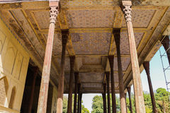 Chehel Sotun Palace Pillars and roofs, Isfahan, Iran. The roof and pillars of the Chehel Sotoun Palace, a pavilion in the middle of a park at the far end of a Royalty Free Stock Images