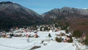 Cheia Mountain Resort , Romania. Cheia Mountain Resort , in Prahova County, Romania, wintertime landscape , with the fir forest and Ciucas mountains peaks stock video