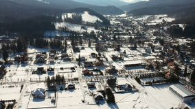 Cheia Mountain Resort , wintertime aerial , Romania. Aerial view of the Cheia Mountain Resort ,a travel destination in Prahova County, Romania, wintertime stock video