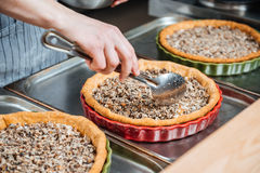 Cheif cook making pie with meat filling on the kitchen Stock Photos
