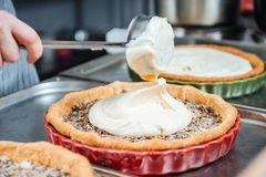 Cheif cook making traditional french pie with cream and filling Royalty Free Stock Images