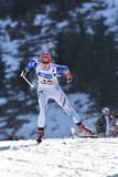 Cheile Gradistei, Румыния - 30-ое января: Неизвестный конкурент в биатлоне 24th чемпионатов мира IBU Youth&Junior стоковая фотография rf