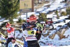 Cheile Gradistei, Roamania - 30-ое января: Неизвестный конкурент в биатлоне чемпионатов мира IBU Youth&Junior стоковое фото