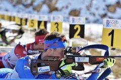 Cheile Gradistei, Roamania - 30 gennaio: Concorrente sconosciuto in IBU Youth& Junior World Championships Biathlon Fotografia Stock
