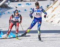 Cheile Gradistei, Roamania - Januari 30: Onbekende concurrent in IBU Youth& Junior World Championships Biathlon vierentwintigste  Royalty-vrije Stock Foto
