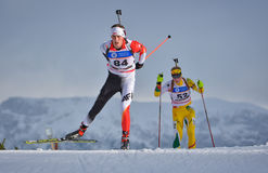 Cheile Gradistei, Roamania - January 24: Unknown copetitor in IBU Youth&Junior World Championships Biathlon 24th of January 2016 t. Cheile Gradistei Royalty Free Stock Images