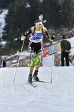 Cheile Gradistei, Romania - 30 gennaio: Concorrente sconosciuto in IBU Youth& Junior World Championships Biathlon ventiquattresim Immagini Stock