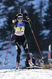 Cheile Gradistei, Rumania - 30 de enero: Competidor desconocido en IBU Youth& Junior World Championships Biathlon 24to foto de archivo