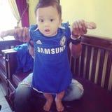 Chelsea behandla som ett barn royaltyfri foto