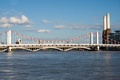 Chelsea Bridge. Over the river Thames against blue sky with white clouds and with Battersea Power station royalty free stock images