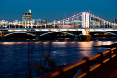 Chelsea bridge focus. Looking down the Thames to Chelsea bridge royalty free stock images