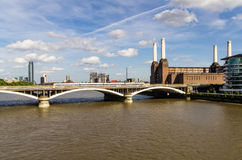 Chelsea Bridge. Over the river Thames in London, Battersea power station in the background royalty free stock image