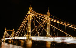 Albert Bridge. Chelsea Bridge pictured at night on river Thames in London England Stock Photography