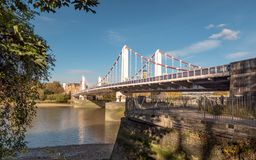 Chelsea Bridge and the River Thames, London. A view from the south bank of Chelsea Bridge passing over London`s River Thames on a bright autumnal day stock images
