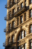 Chelsea building with wrought iron balcony and fire escape, Manh Stock Photos