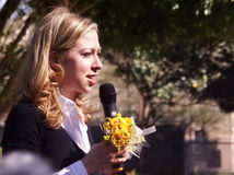 Chelsea Clinton talks with flower bouquet in hand Stock Image