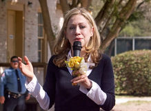 Chelsea Clinton talks with flowers in hand Royalty Free Stock Images