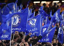 Chelsea fans waving flags Stock Photos