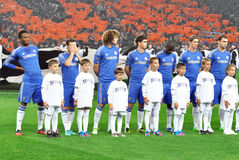 Chelsea football team and with kids on a stadium royalty free stock photos