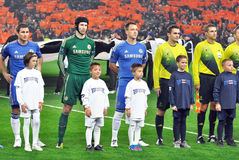 Chelsea football team and referee with kids Stock Images