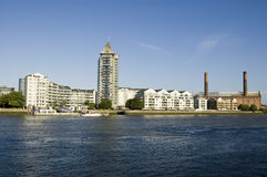 Chelsea Harbour Development, London. The expensive riverside apartments of Chelsea Harbour overlooking the Thames in London.  The disused Lots Road Power Station Royalty Free Stock Photo