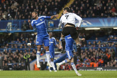 Chelsea. LONDON, ENGLAND. 06 DECEMBER 2011. Chelsea's English defender Ashley Cole and Valencia's Brazilian forward Jonas compet for the ball in the air during Stock Photos