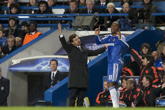 Chelsea. LONDON, ENGLAND. 06 DECEMBER 2011. Chelsea's Portuguese manager Andre Villas-Boas and Chelsea's Ivory Coast forward Didier Drogba in action during the Stock Photography