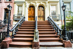 Chelsea NYC Homes. Typical exterior steps and doors on residential homes in the Chelsea district in New York City royalty free stock image