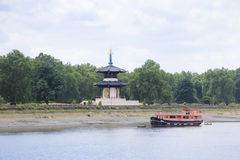 Chelsea peace pagoda river thames london uk. Chlesea peace pagoda in battersea park london uk next to the river thames Stock Photo