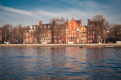 Chelsea riverfront with typical British buildings. London, UK. Typical residential houses in brick building on Chelsea riverfront on the river Thames, London Royalty Free Stock Photo
