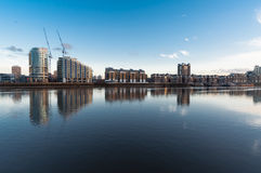 Chelsea seafront, Cityscape by the river Thames. Seafront by the river Thames in London, UK. Modern and typical buildings by the water, with sunny sky and royalty free stock photos