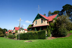 Chelsea Sugar Refinery. AUCKLAND, NZ  - MAY 29:Chelsea Sugar Refinery village on May 29 2013.Built in 1909, the row of brick workers' cottages remain in Chelsea' Stock Photo