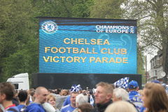 Chelsea victory parade on a big screen in Fulham. Supporters of Chelsea football club gathered in front of a big screen during the victory parade after Chelsea Royalty Free Stock Image