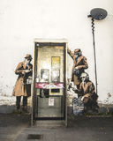 CHELTENHAM, GROSSBRITANNIEN - 16. APRIL 2014: Graffiti, vielleicht Banksy-Kunst Stockfotografie