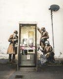 CHELTENHAM UK - APRIL 16, 2014: Grafitti eventuellt Banksy konst Arkivbild