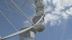 Cheltenham, United Kingdom. June 22, 2019 - White ferris wheel of the amusement park in the blue sky background. Cheltenham, United Kingdom. June 22, 2019 stock video footage