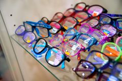 Chelyabinsk Region, Russia - February 2019. Showcase with glasses. Samples of multi-colored frames for glasses royalty free stock images