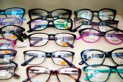 Chelyabinsk Region, Russia - February 2019. Showcase with glasses. Samples of multi-colored frames for glasses