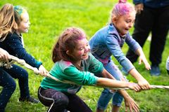 Chelyabinsk Region, Russia - July 2019. Children of different nationalities are friends at the festival of colors. Tug of war.