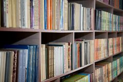 Chelyabinsk region, Russia - March 2019. Shelving with books in the school library. Library bookshelves.