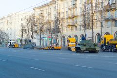 The heavy tank IS-2 is preparing to drive along the gangways on the trawl. Chelyabinsk, Russia - May 2019: Tanks on Lenin Avenue are preparing for loading on stock photos